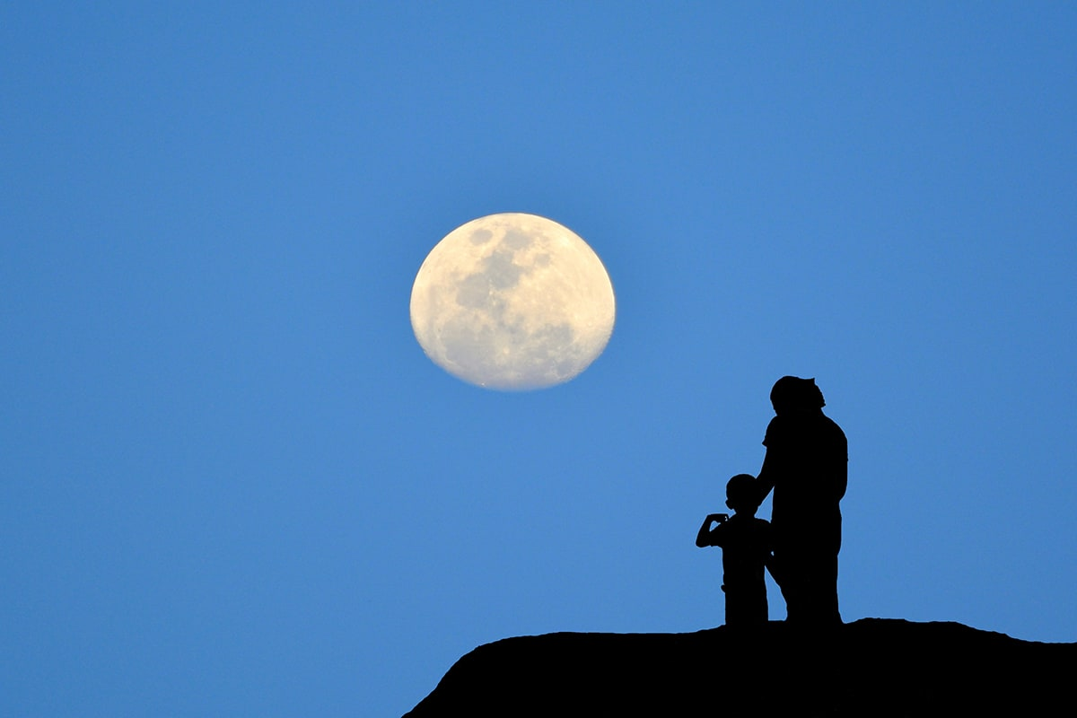 Adult and child viewing the Moon