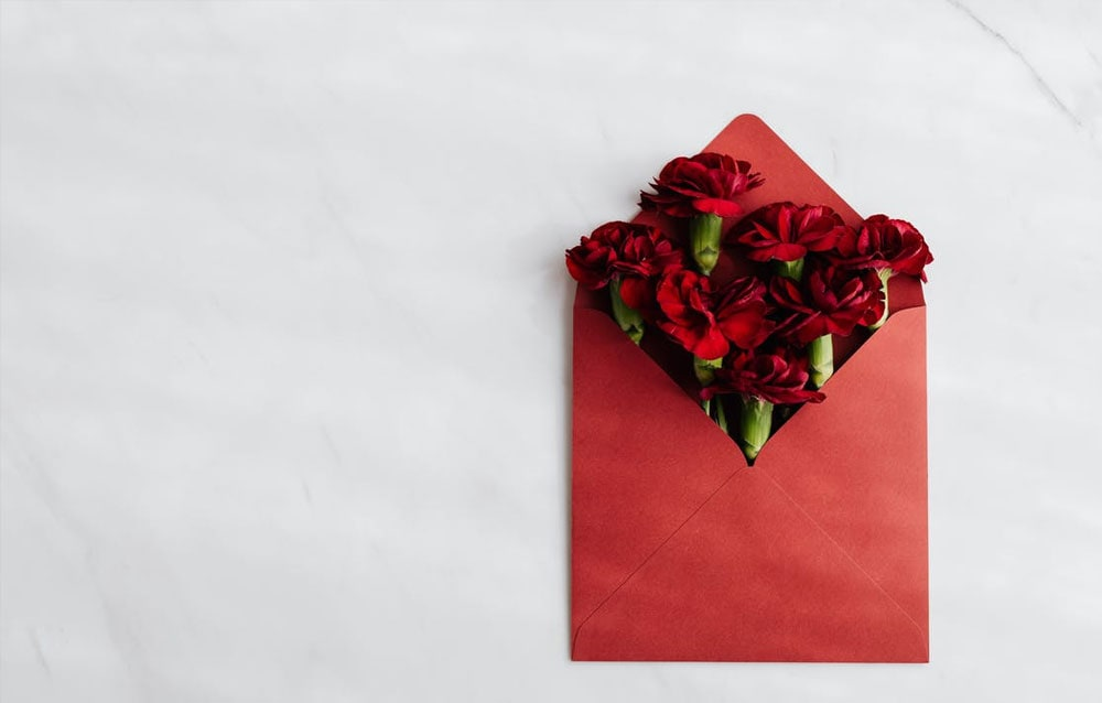 red envelope with roses